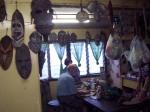 Ralf discusses Sepik carvings with US Ambassador, Leslie Rowe