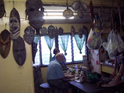Ralf discusses Sepik carvings with US Ambassador, Leslie Rowe